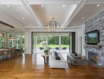 hidden sliding tv barn door luxury lowcountry home