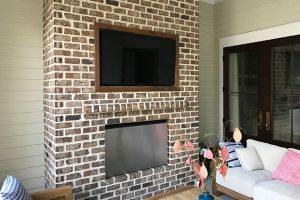 Custom Framed TV Recessed on a Brick Wall