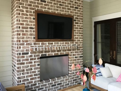 Custom Framed TV Recessed on a Brick Wall
