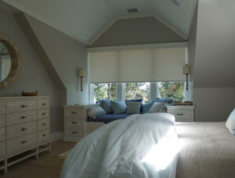 Closed Lutron Roller Shades in a Bedroom