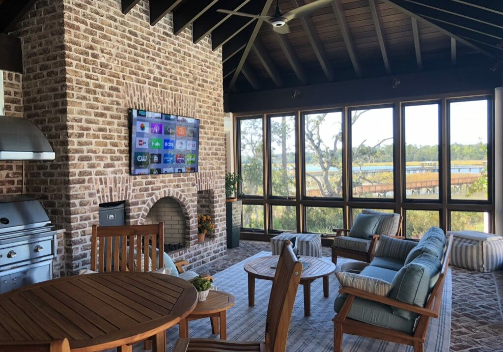 "Outdoor porch with 65"" Sony A1E OLED TV and Niles In-Ceiling type overhead speakers."